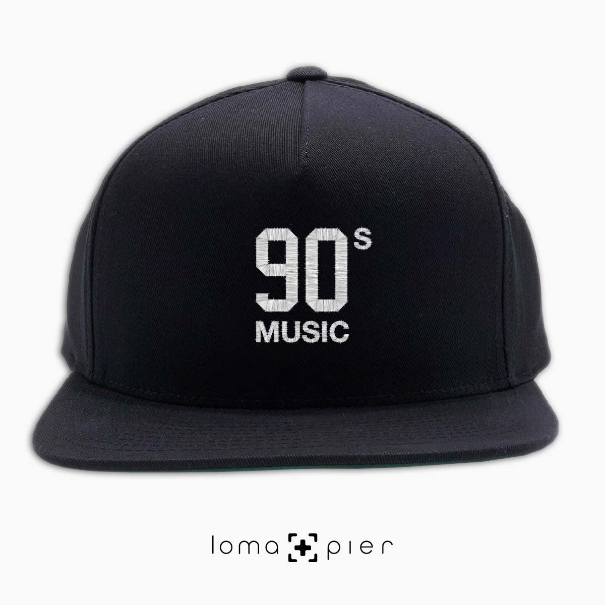 90's MUSIC typography embroidered on a black classic snapback hat with white thread by loma+pier hat store