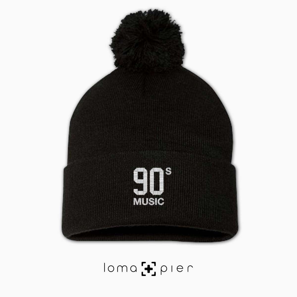 90's MUSIC typography embroidered on a black pom pom beanie with white thread by loma+pier hat store