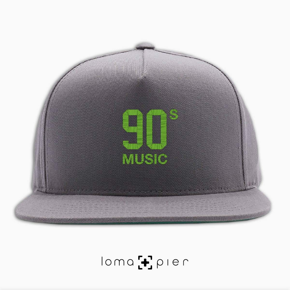 90's MUSIC typography embroidered on a grey classic snapback hat with lime green thread by loma+pier hat store