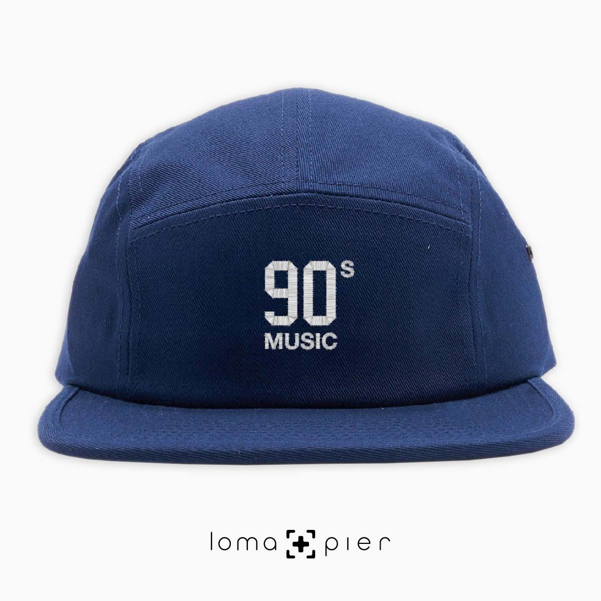 90's MUSIC typography embroidered on a navy blue cotton 5-panel hat with white thread by loma+pier hat store