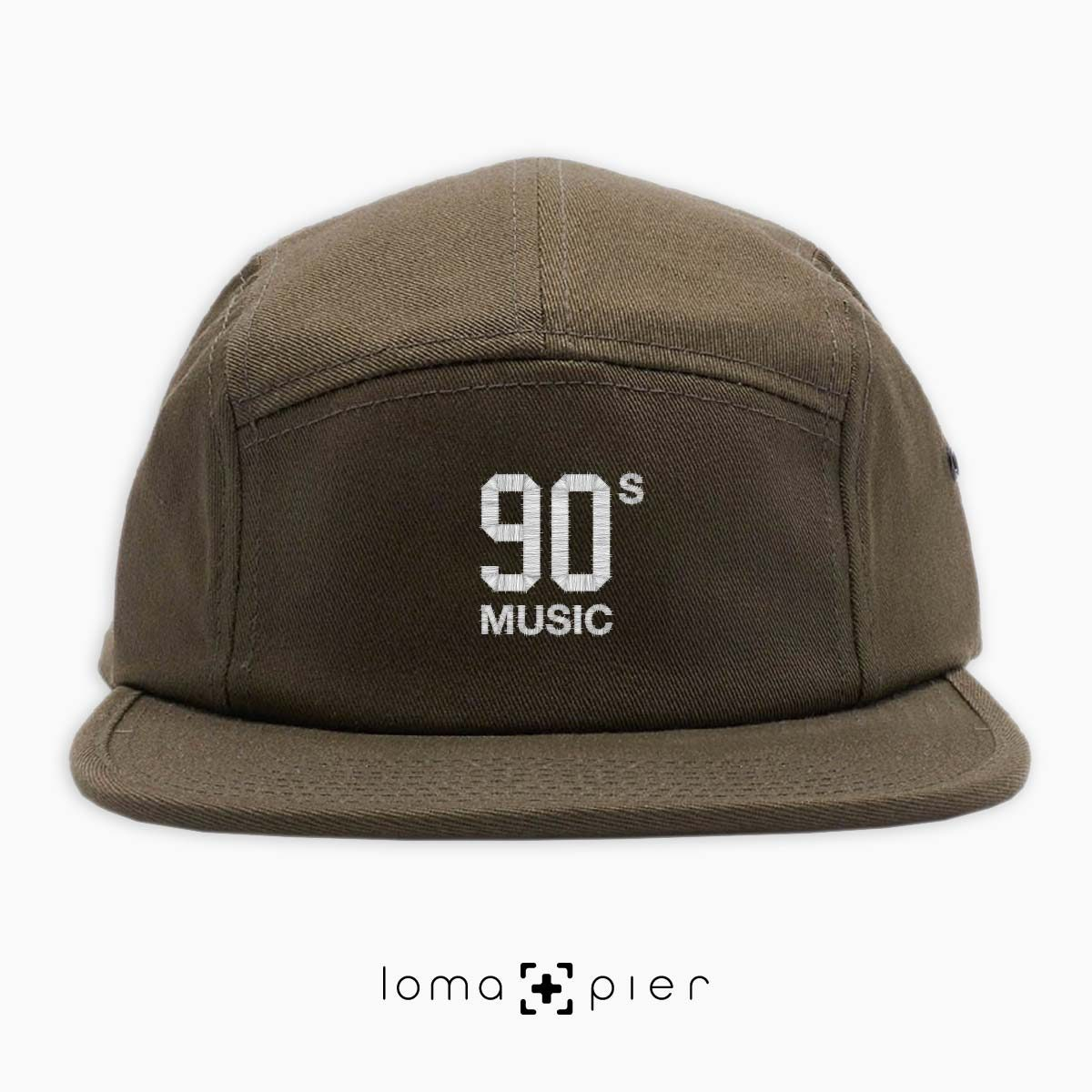 90's MUSIC typography embroidered on an olive green cotton 5-panel hat with white thread by loma+pier hat store
