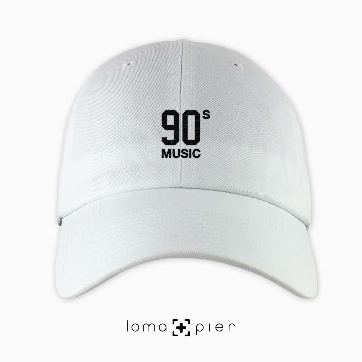 90's MUSIC typography embroidered on a white unstructured dad hat with black thread by loma+pier hat store made in the USA