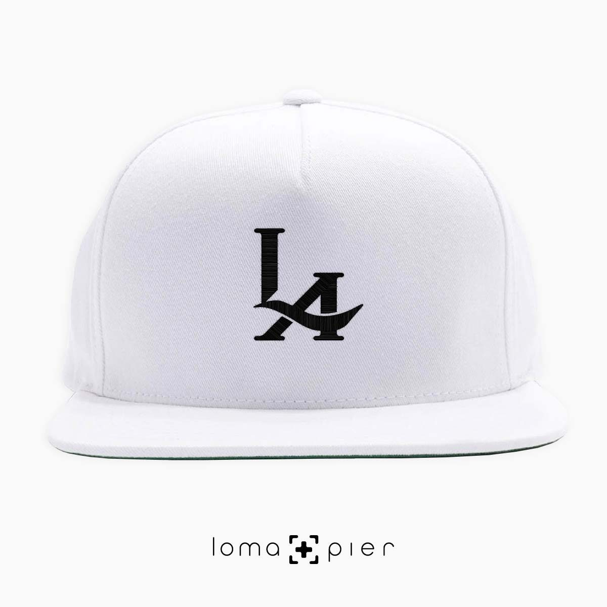 los angeles LA logo embroidered on a white classic snapback hat by loma+pier hat store