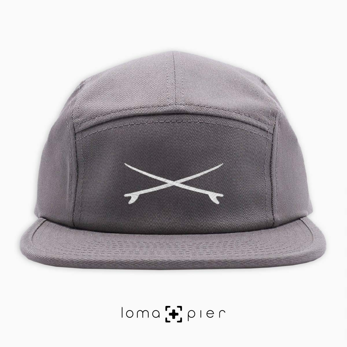X MARKS THE SPOT icon embroidered on a grey cotton 5-panel hat by loma+pier hat store
