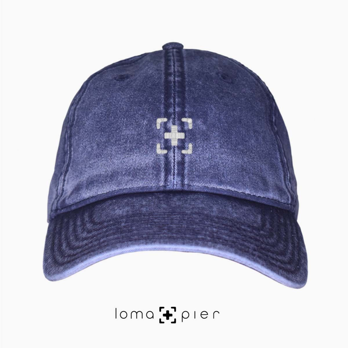 navy washed out vintage dad hats with loma and pier icon