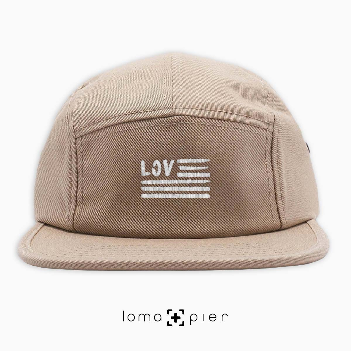 AMERICAN LOVE icon embroidered on a khaki cotton 5-panel hat with white thread by loma+pier hat store