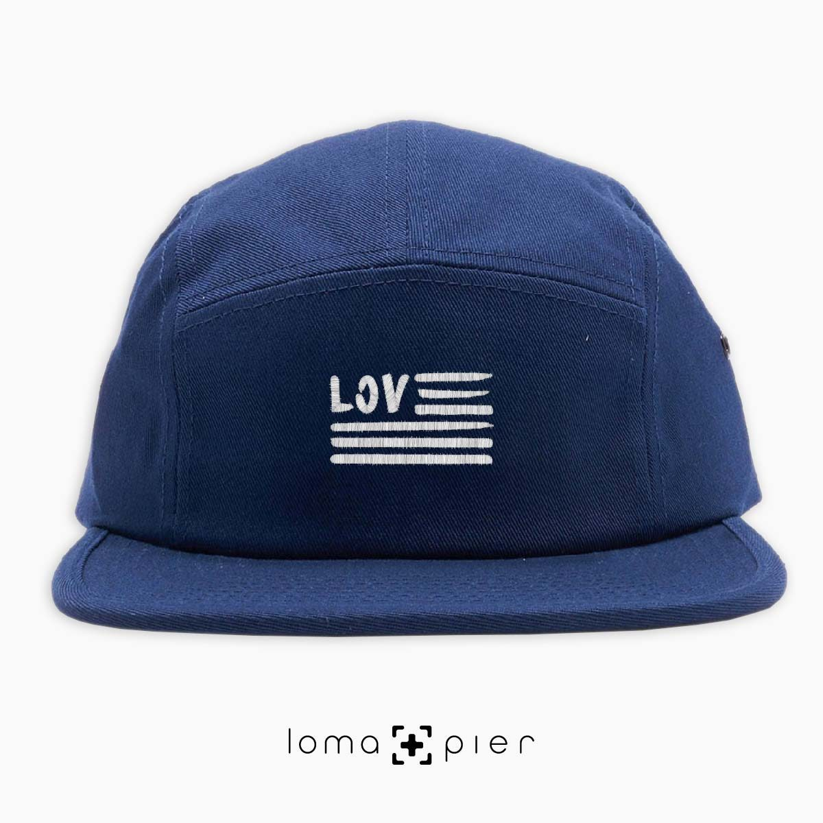 AMERICAN LOVE icon embroidered on a navy blue cotton 5-panel hat with white thread by loma+pier hat store