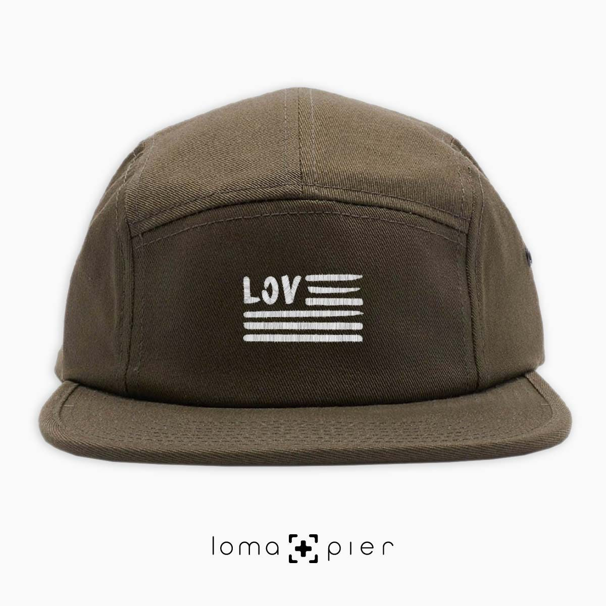 AMERICAN LOVE icon embroidered on an olive green cotton 5-panel hat with white thread by loma+pier hat store