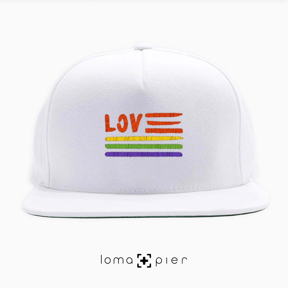 AMERICAN LOVE ​GAY PRIDE icon embroidered on a white classic snapback hat with multicolor thread by loma+pier hat store