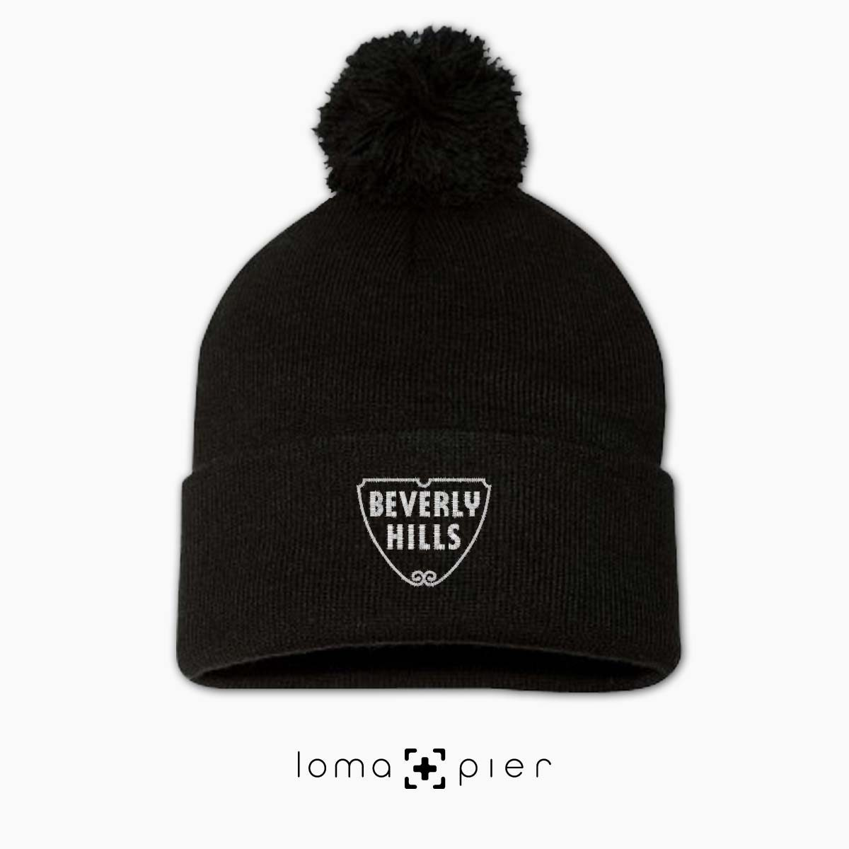 BEVERLY HILLS typography embroidered on a black pom pom beanie with white thread by loma+pier hat store