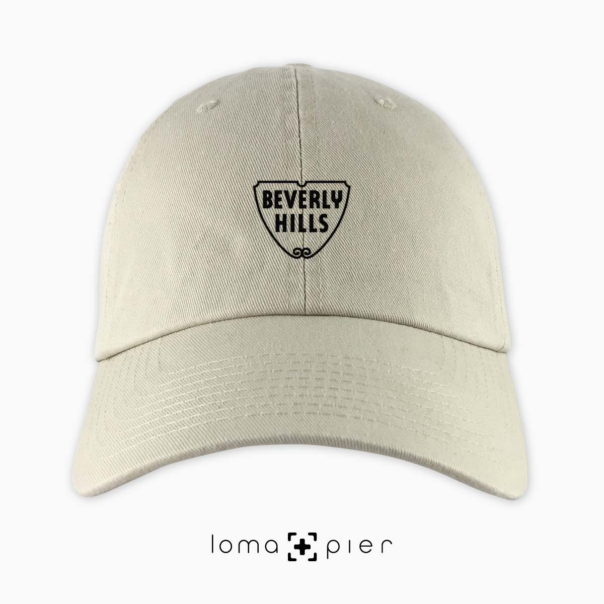 ​BEVERLY HILLS icon embroidered on a ​​khaki unstructured dad hat with ​black thread by loma+pier hat store made in the USA