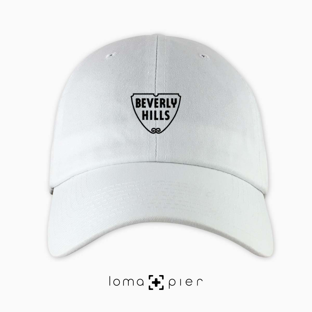 ​BEVERLY HILLS icon embroidered on a ​white unstructured dad hat with ​black thread by loma+pier hat store made in the USA