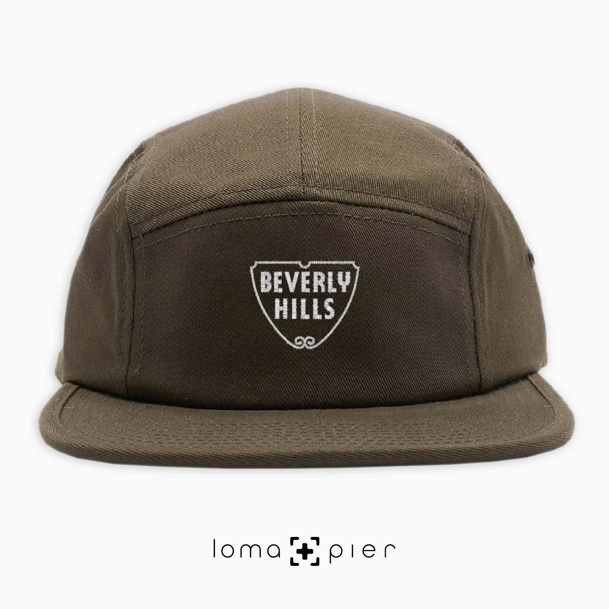 BEVERLY HILLS typography embroidered on an olive green cotton 5-panel hat with white thread by loma+pier hat store