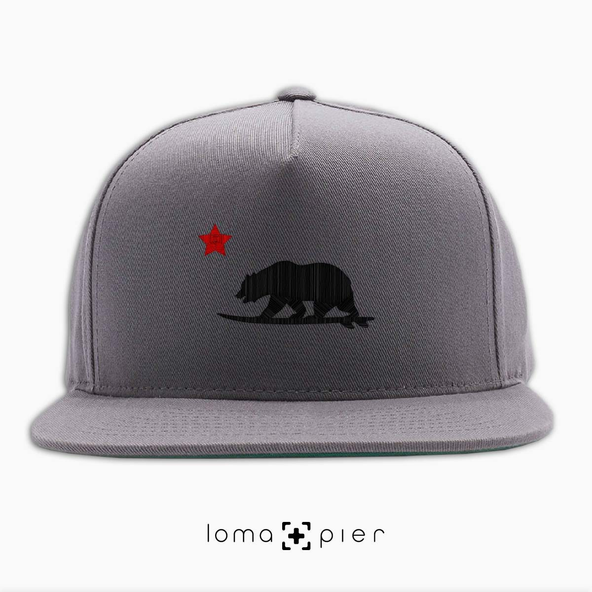 CALI SURFER icon embroidered on a grey classic snapback hat with black and red thread by loma+pier hat store
