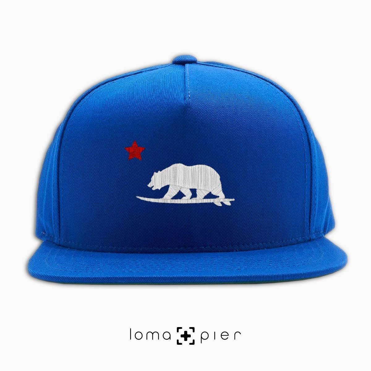 CALI SURFER icon embroidered on a royal blue classic snapback hat with white and red thread by loma+pier hat store
