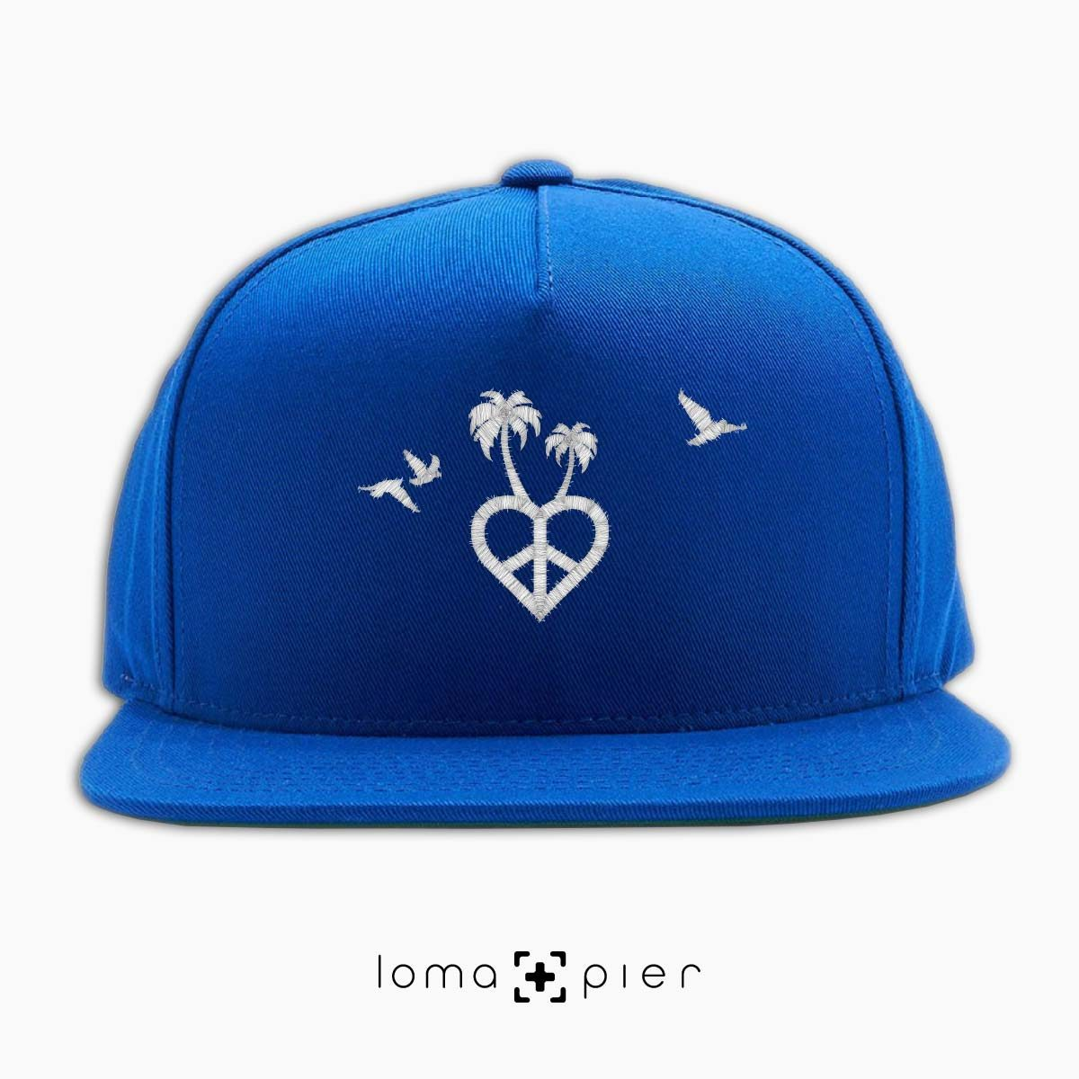 CALI VIBES icon embroidered on a royal blue classic snapback hat with white thread by loma+pier hat store