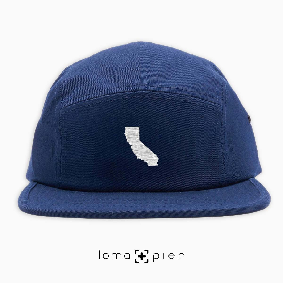 CALIFORNIA silhouette icon embroidered on a navy blue cotton 5-panel hat by loma+pier hat store