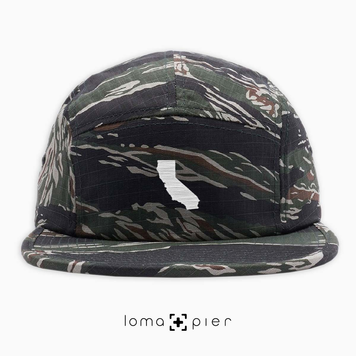 CALIFORNIA silhouette icon embroidered on a tiger camo cotton 5-panel hat by loma+pier hat store