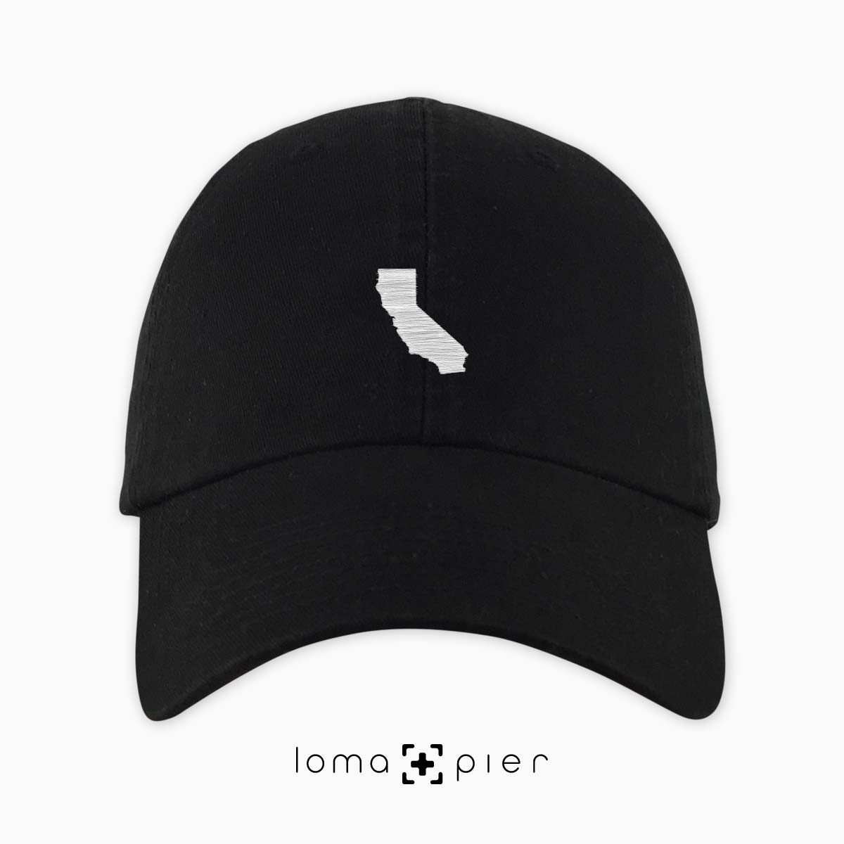 CALIFORNIA silhouette icon embroidered on a black unstructured dad hat by loma+pier hat store made in the USA