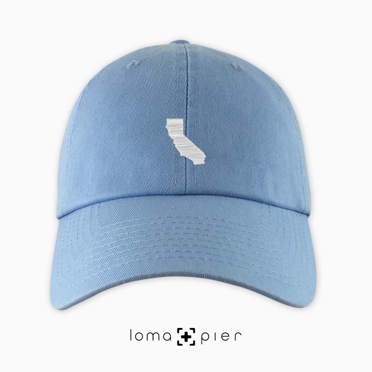 CALIFORNIA silhouette icon embroidered on a light blue unstructured dad hat by loma+pier hat store made in the USA