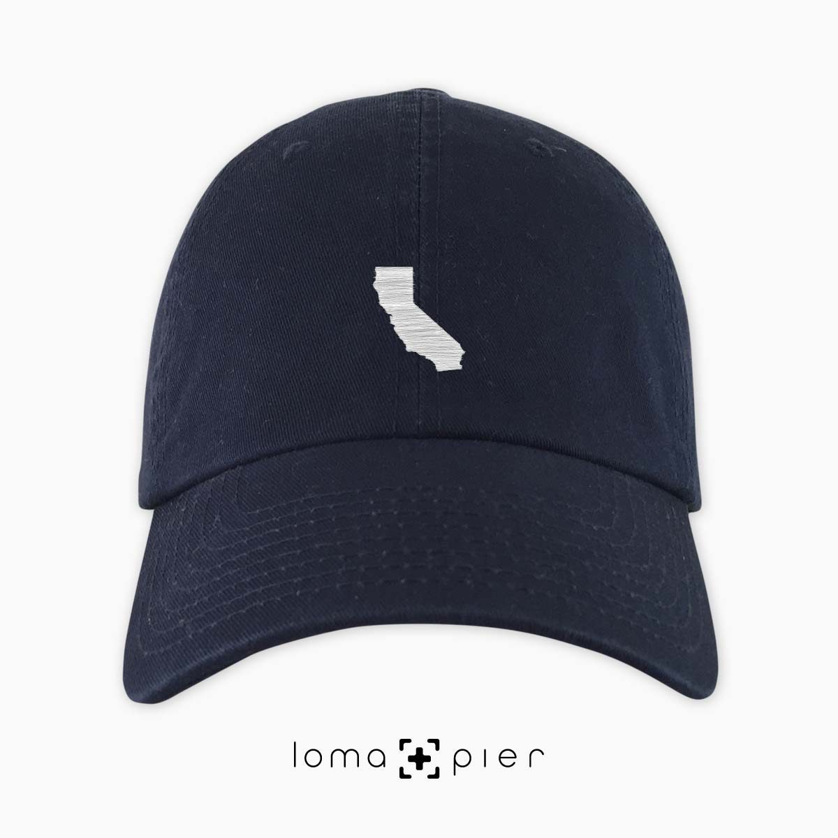 CALIFORNIA silhouette icon embroidered on a navy blue unstructured dad hat by loma+pier hat store made in the USA