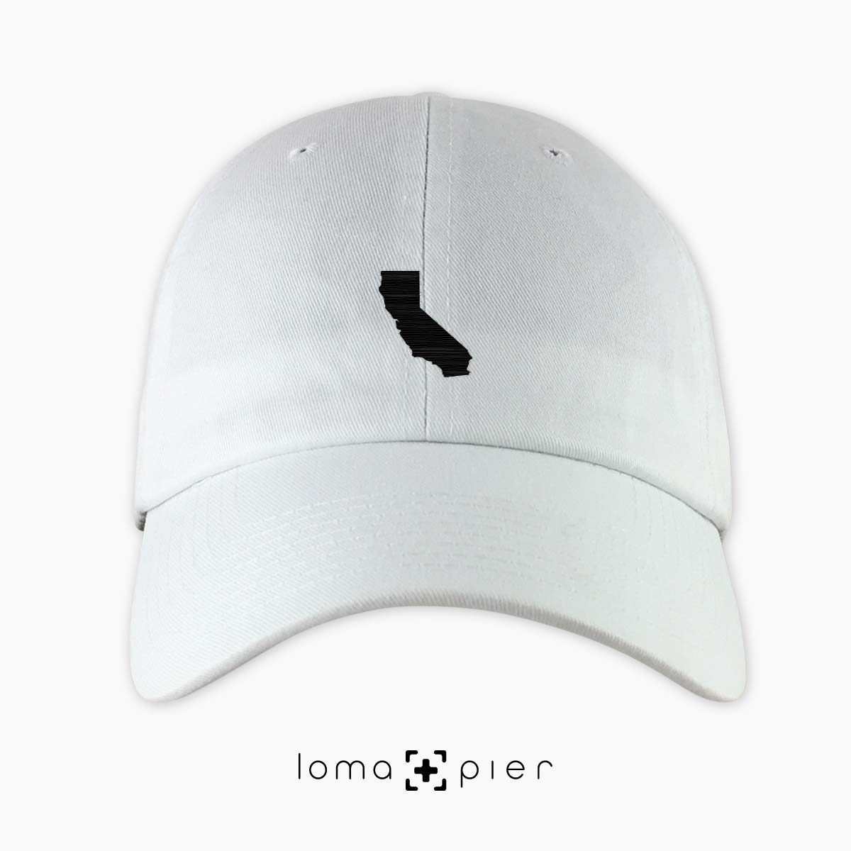 CALIFORNIA silhouette icon embroidered on a white unstructured dad hat by loma+pier hat store made in the USA