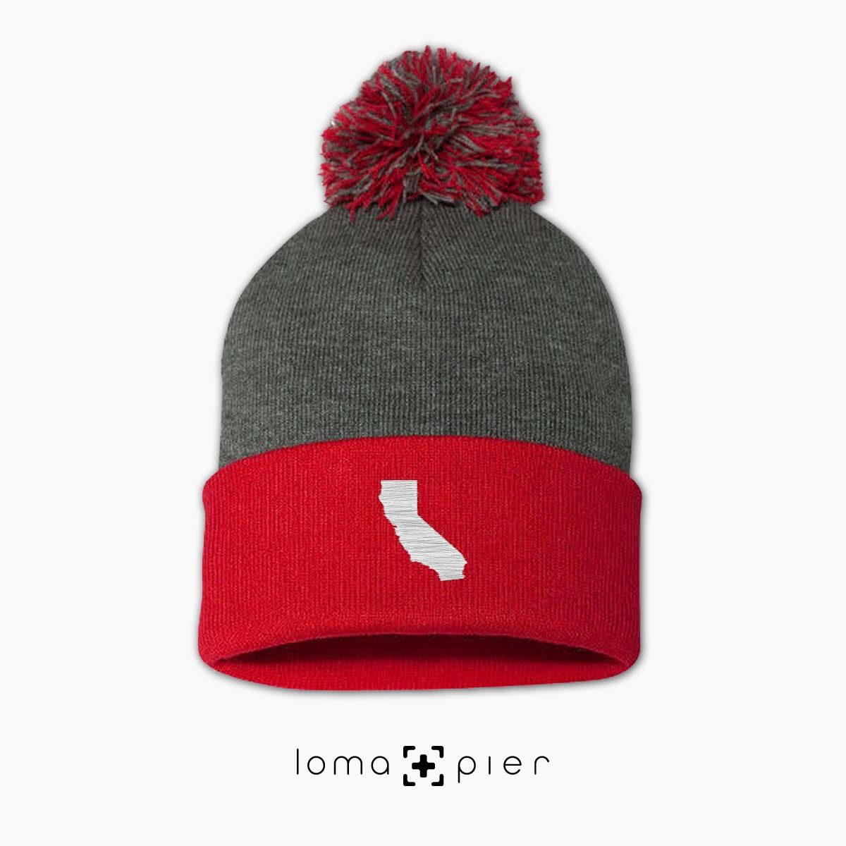 CALIFORNIA silhouette icon embroidered on a grey red pom pom beanie by loma+pier hat store
