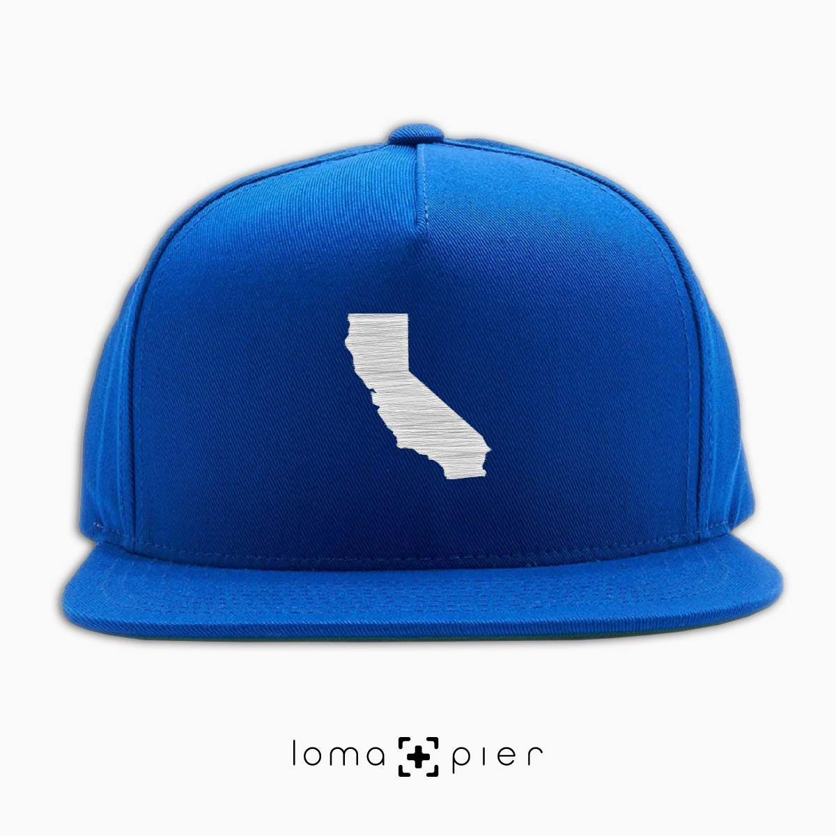 CALIFORNIA silhouette icon embroidered on a royal blue classic snapback hat by loma+pier hat store