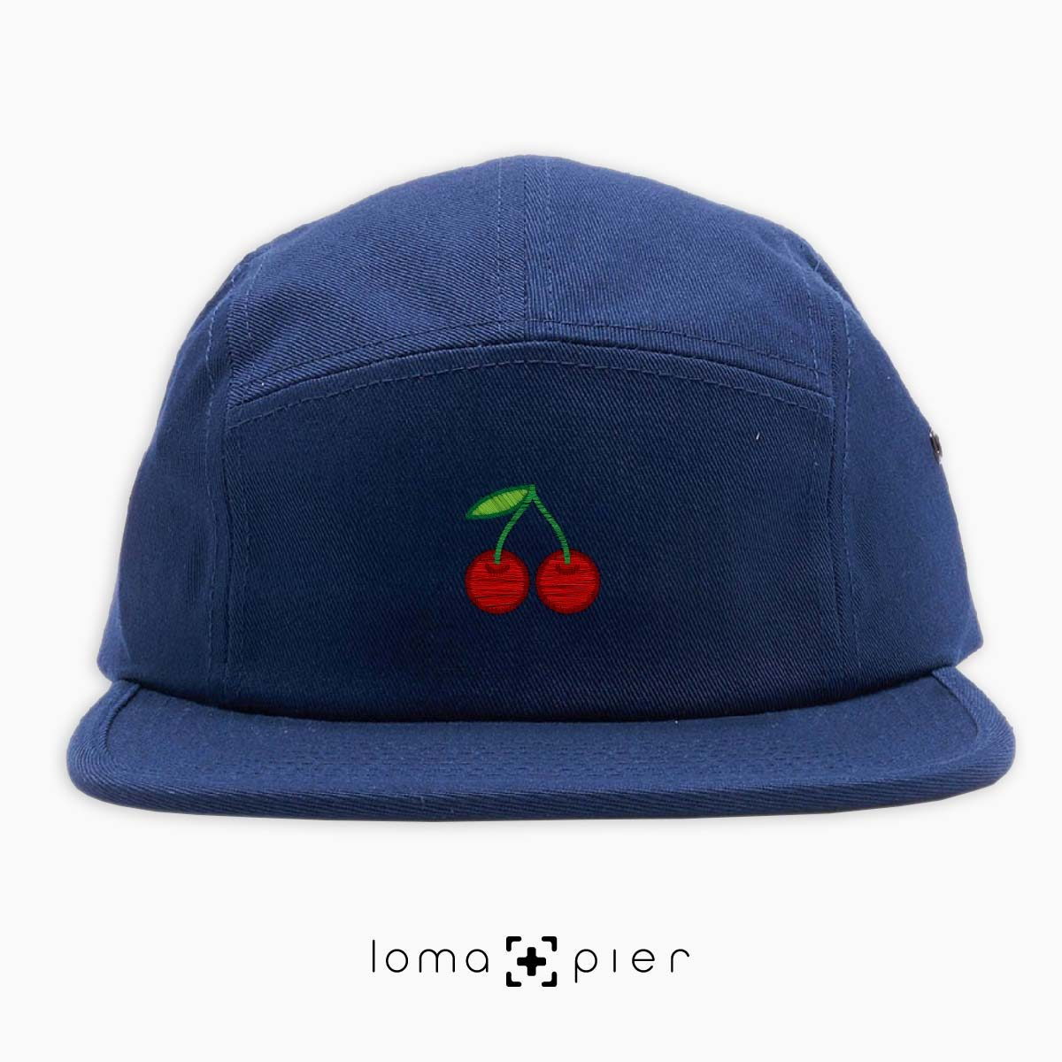 CHERRIES icon embroidered on a navy blue cotton 5-panel hat by loma+pier hat store