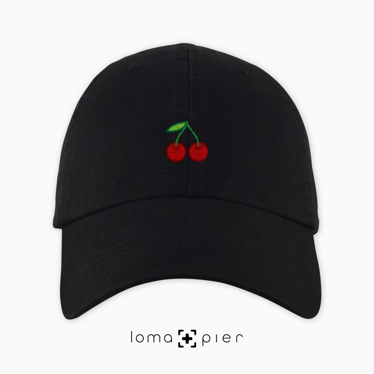 CHERRIES icon embroidered on a black dad hat by loma+pier hat store made in the USA