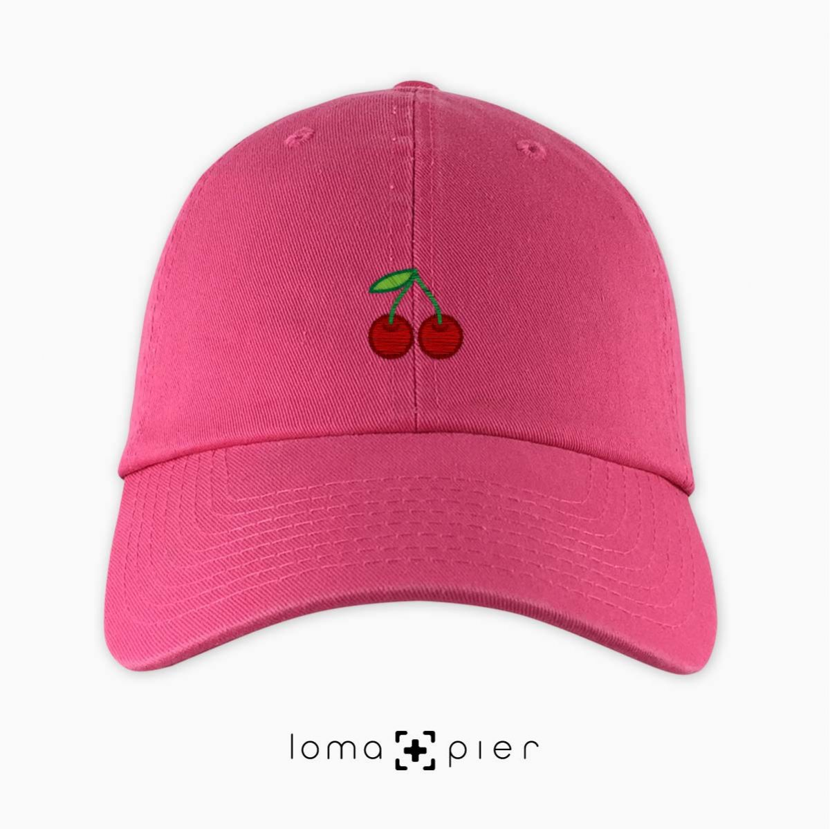 CHERRIES icon embroidered on a pink dad hat by loma+pier hat store made in the USA