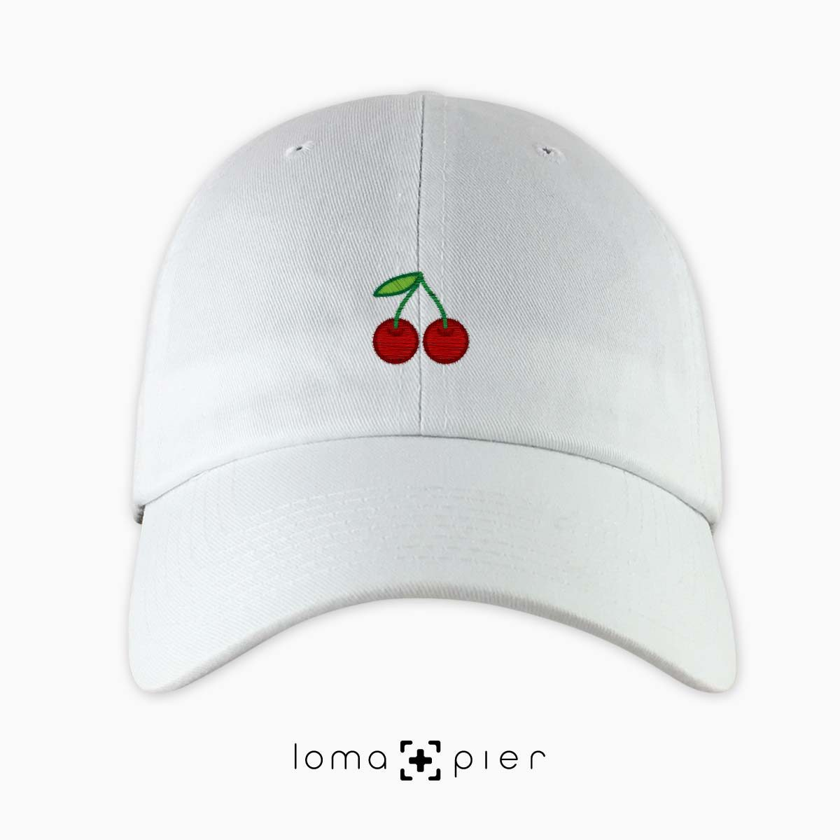 CHERRIES icon embroidered on a white dad hat by loma+pier hat store made in the USA
