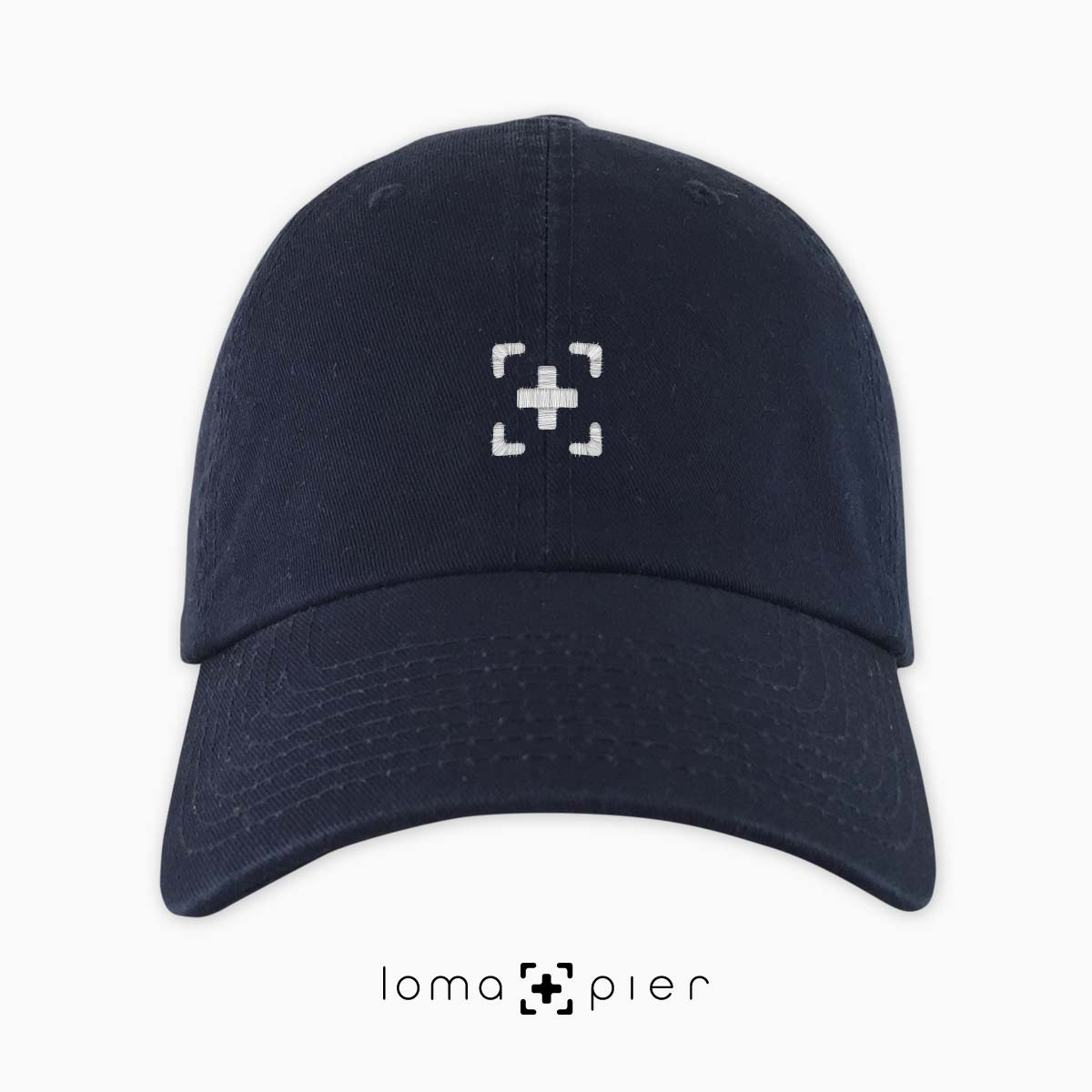dad hat with icon in navy blue by loma+pier hat store