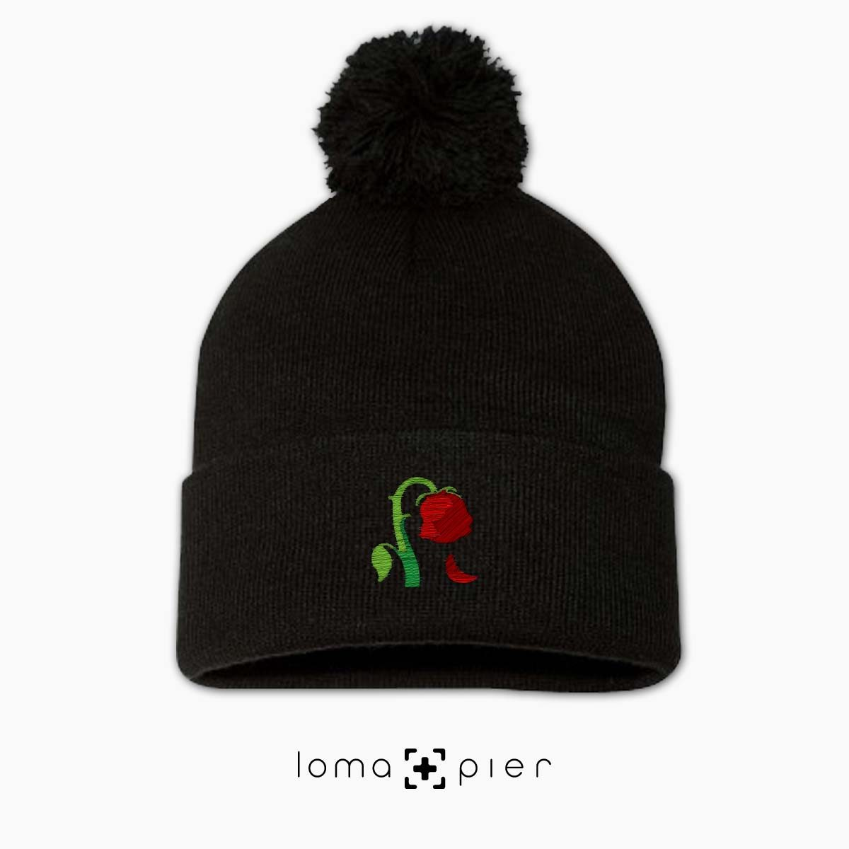 DYING ROSE EMOJI icon embroidered on a black pom pom beanie by loma+pier hat store