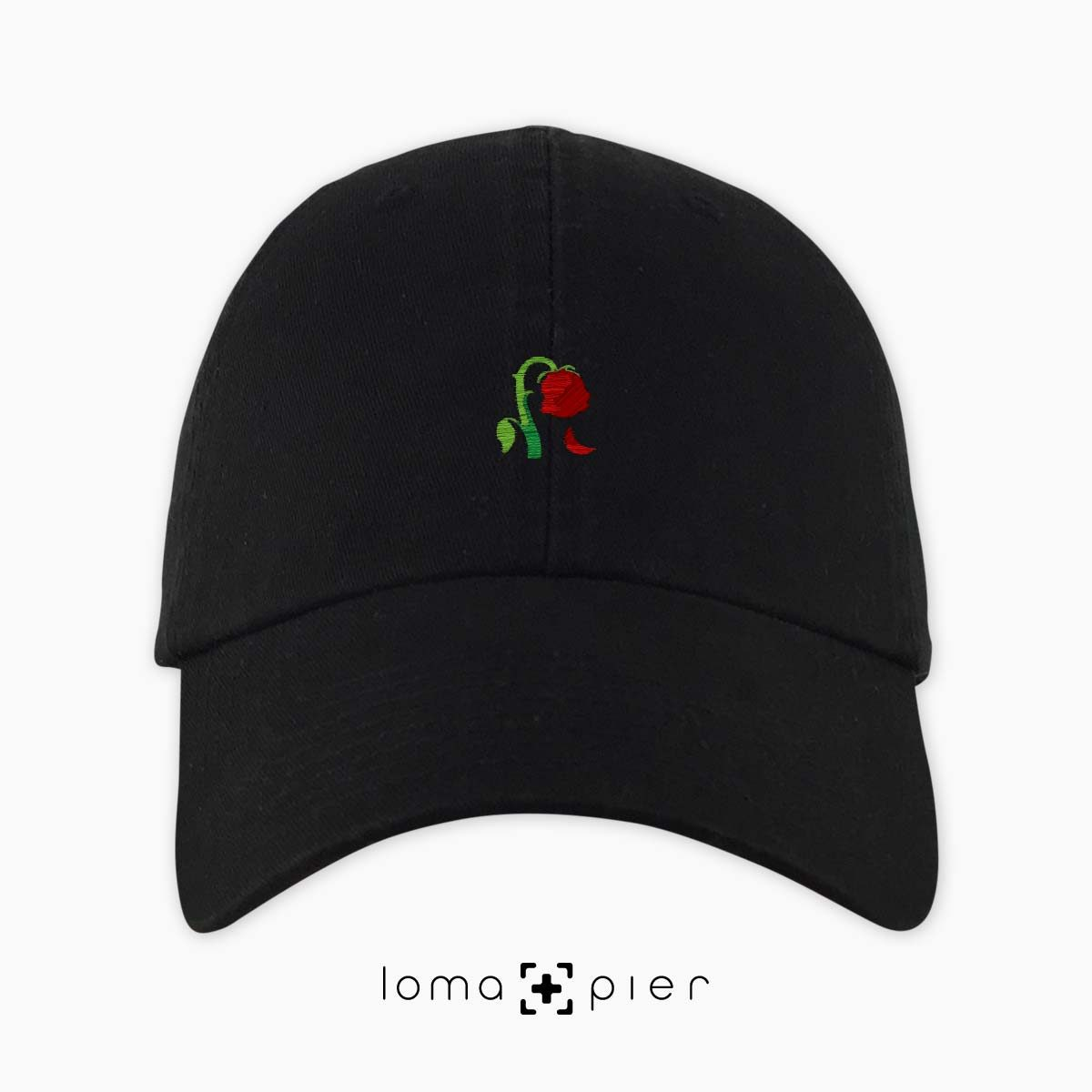 DYING ROSE EMOJI icon embroidered on a black unstructured dad hat by loma+pier hat store made in the USA