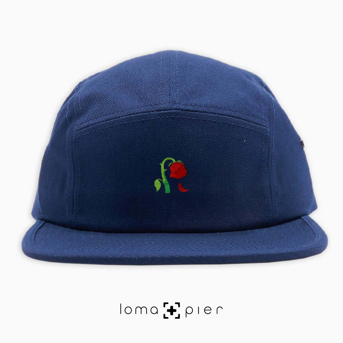 DYING ROSE EMOJI icon embroidered on a navy blue cotton 5-panel hat by loma+pier hat store