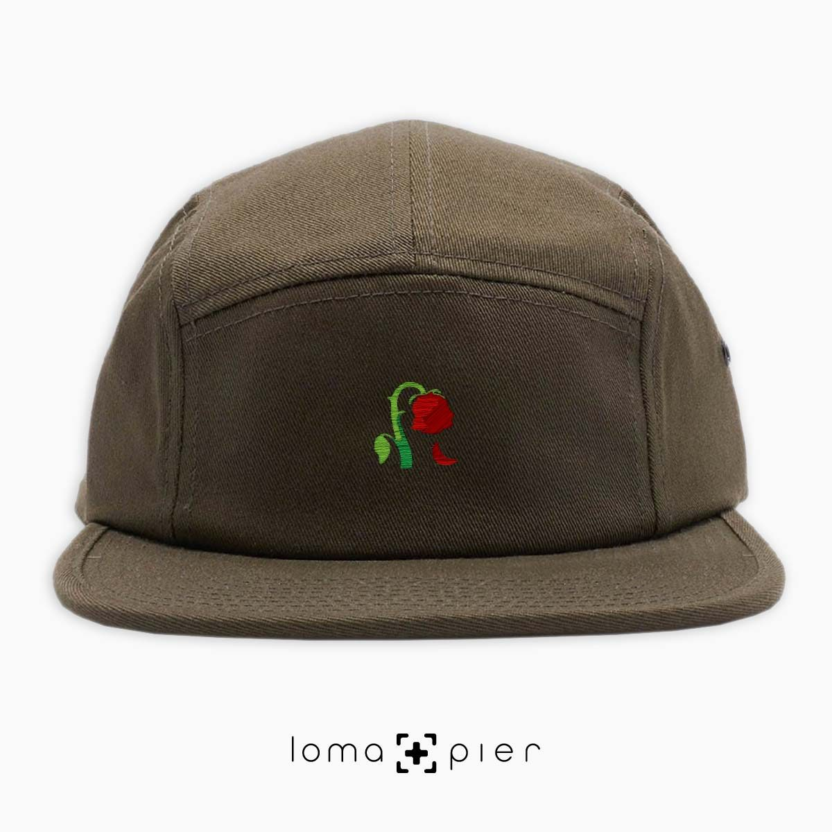 DYING ROSE EMOJI icon embroidered on an olive green cotton 5-panel hat by loma+pier hat store