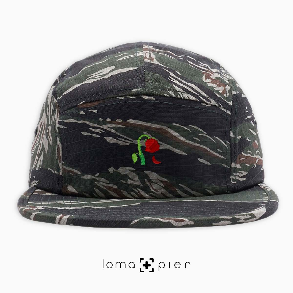 DYING ROSE EMOJI icon embroidered on a tiger camo cotton 5-panel hat by loma+pier hat store