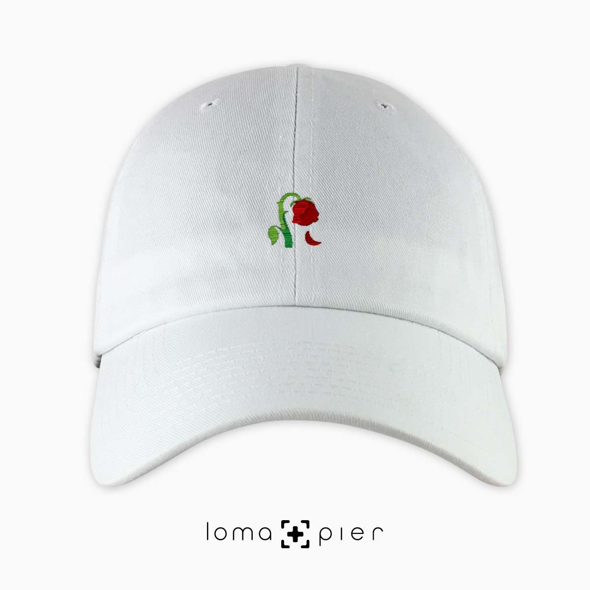 DYING ROSE EMOJI icon embroidered on a white unstructured dad hat by loma+pier hat store made in the USA