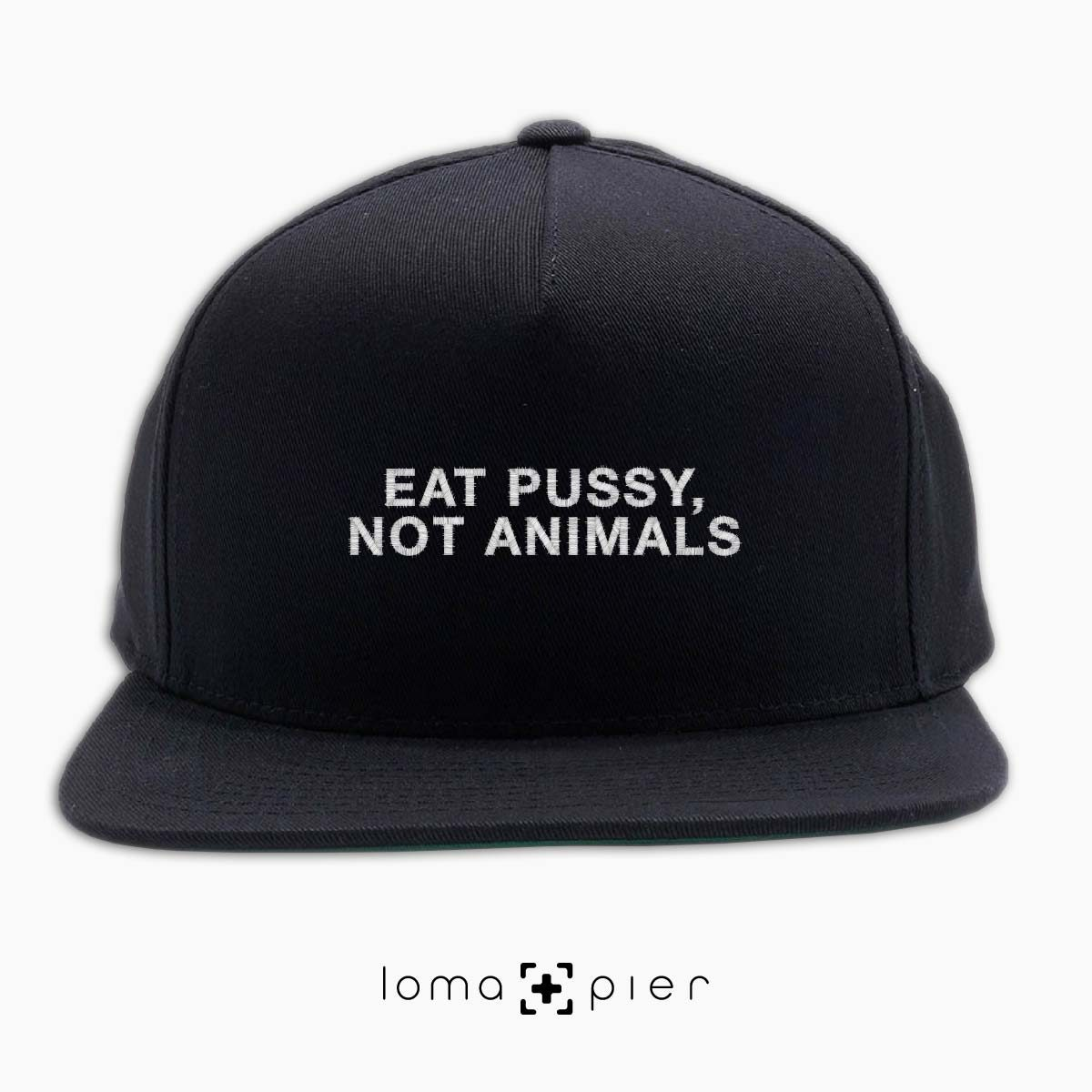 EAT PUSSY NOT ANIMALS typography embroidered on a black classic snapback hat with white thread by loma+pier hat store
