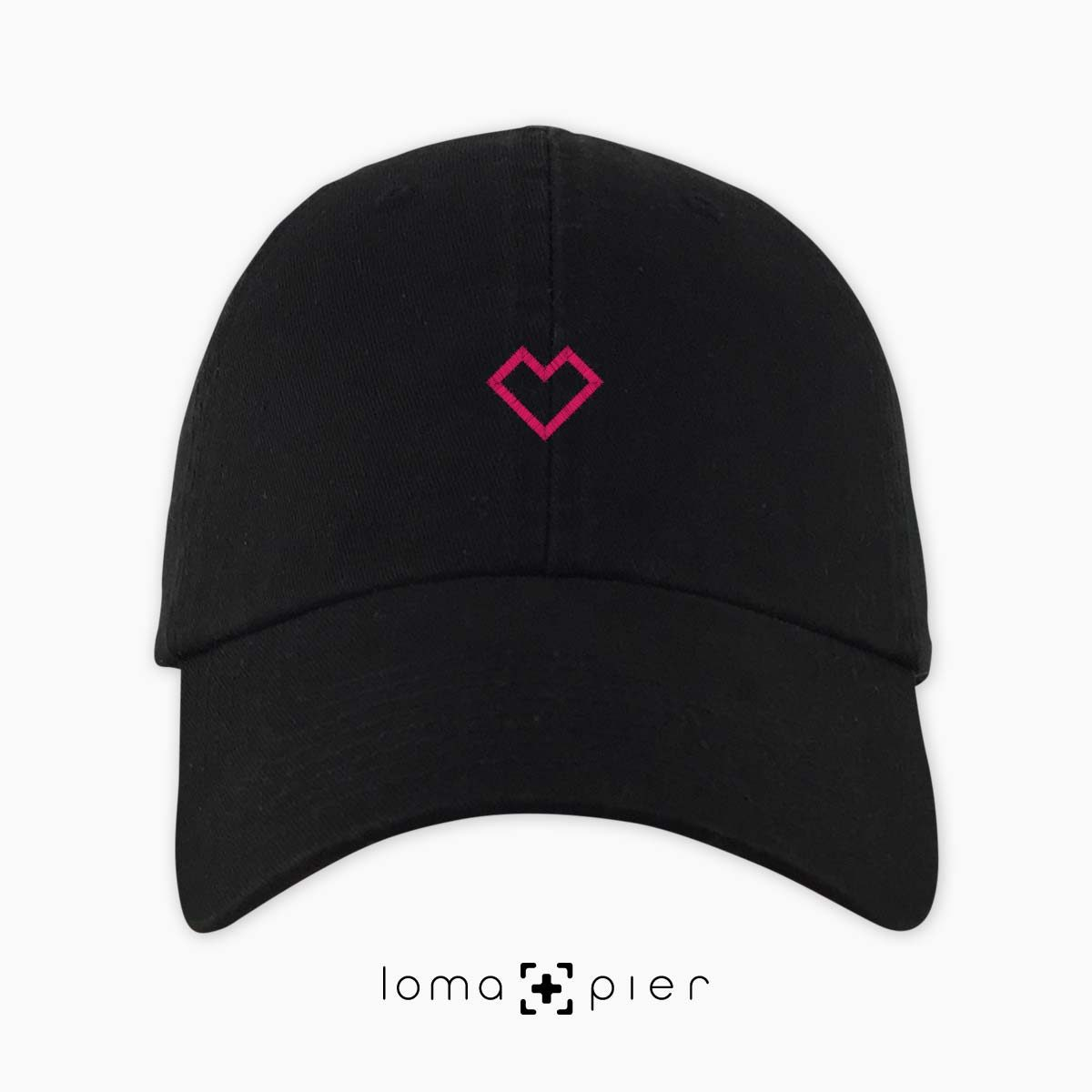 EDGY HEART icon embroidered on a black unstructured dad hat with pink thread by loma+pier hat store made in the USA