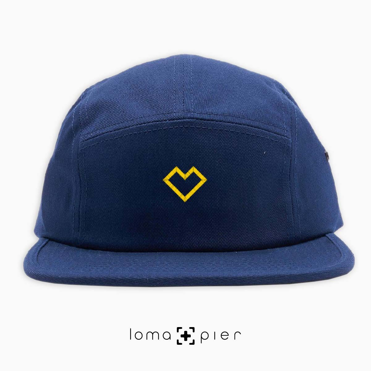 EDGY HEART typography embroidered on a navy blue cotton 5-panel hat with yellow thread by loma+pier hat store