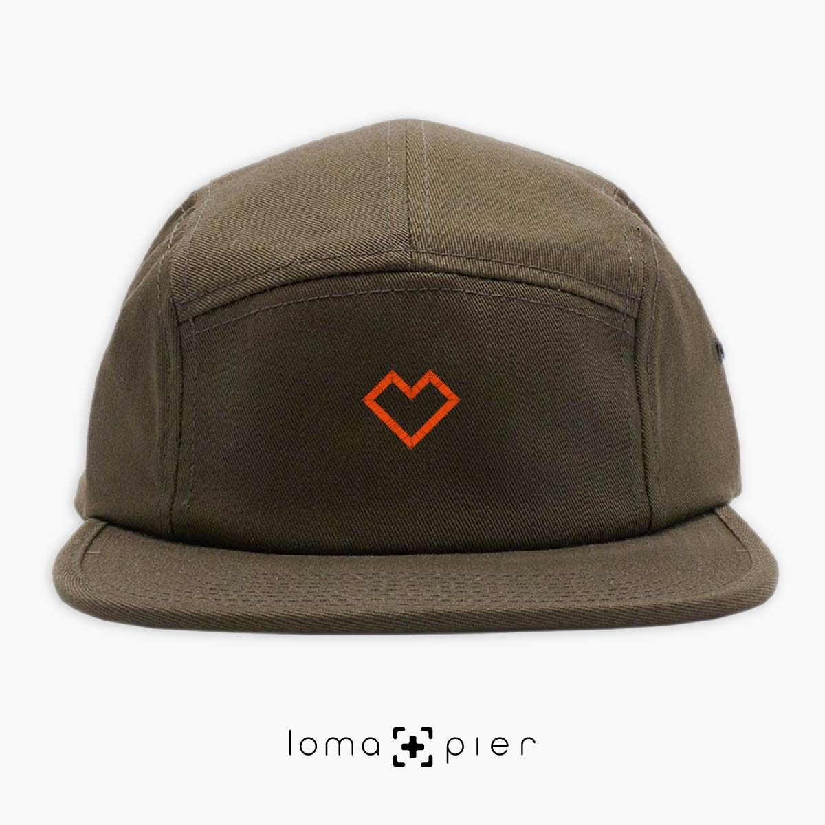 EDGY HEART typography embroidered on an olive green cotton 5-panel hat with orange thread by loma+pier hat store