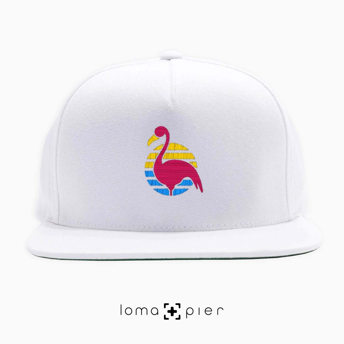FLAMINGO icon embroidered on a white classic snapback hat by loma+pier hat store