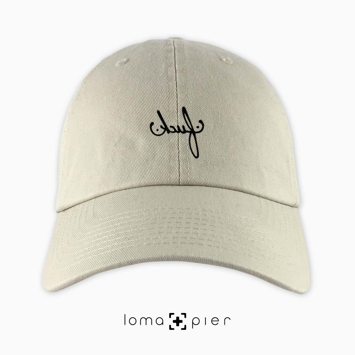 F#CK typography embroidered on a khaki unstructured dad hat with black thread by loma+pier hat store made in the USA