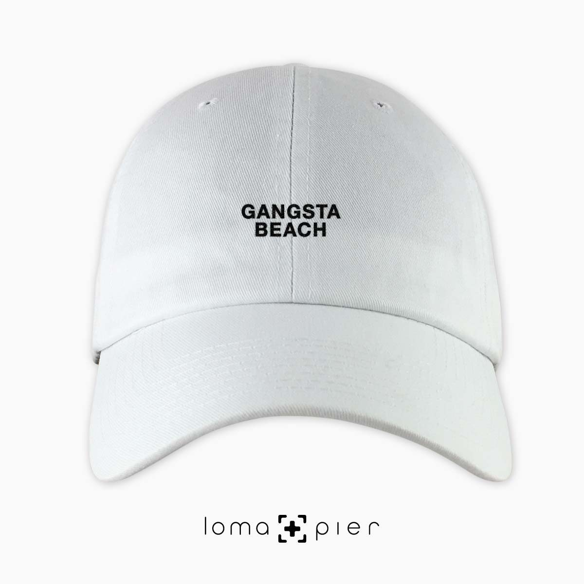 GANGSTA BEACH embroidered on a white unstructured dad hat by loma+pier hat store made in the USA