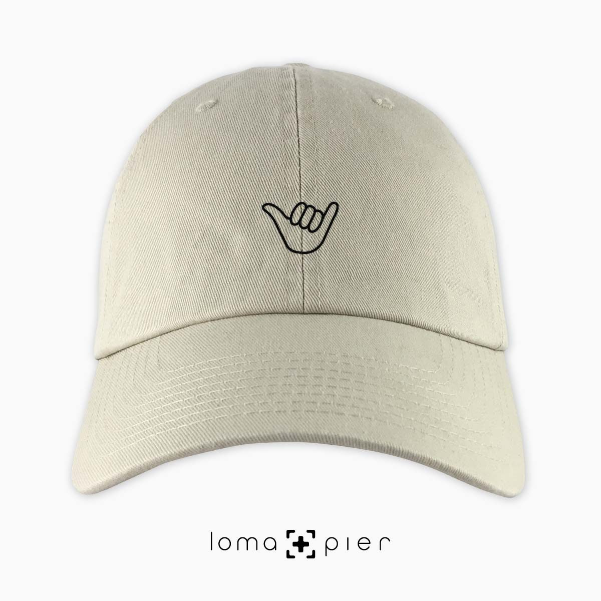 HANG LOOSE icon embroidered on a khaki unstructured dad hat by loma+pier hat store made in the USA