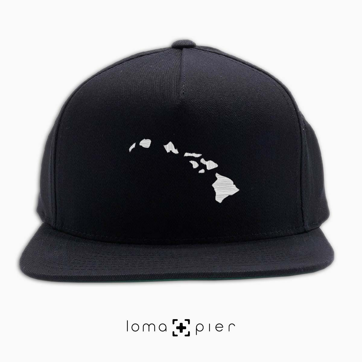 HAWAIIAN ISLANDS icon embroidered on a black classic snapback hat by loma+pier hat store