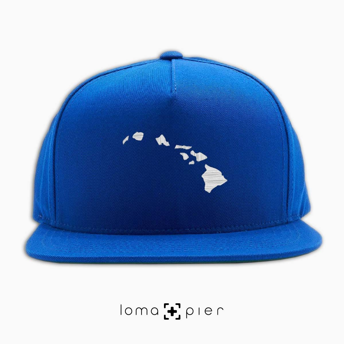 HAWAIIAN ISLANDS icon embroidered on a royal blue classic snapback hat by loma+pier hat store