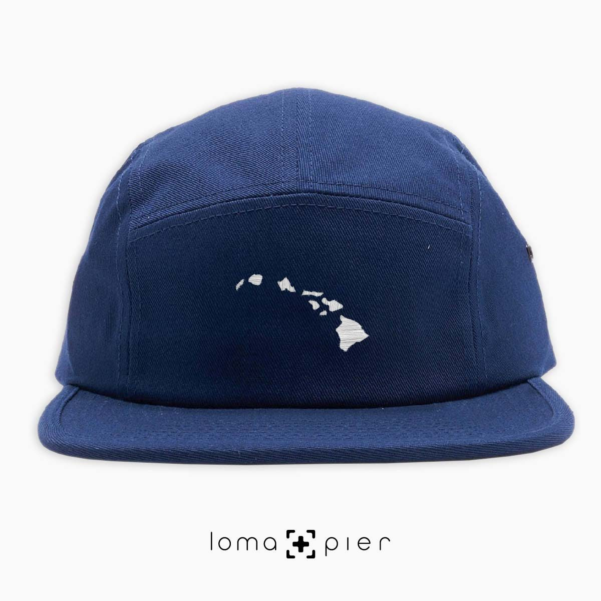 HAWAIIAN ISLANDS icon embroidered on a navy cotton 5-panel hat by loma+pier hat store